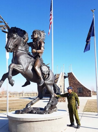 "Ute tribe story teller and Viet Nam veteran Larry Cesspooch at the warrior statue at the BoƩ le Hollow Veteran's Memorial on the Ute ReservaƟ on in Fort Duchesne, Utah. Cesspooch draws on his own war experience to comment on the long ago war story of Chief Sanpitch in the Discovery Road show ""The Lost Tomahawk."""